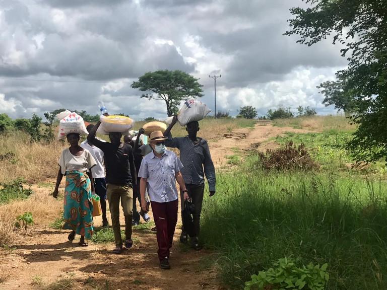 Mozambique, Cabo Delgado province 2021Salesian Missionary Fr. Edegard Silva Junior (from Brazil) and parishioners with relief supplies