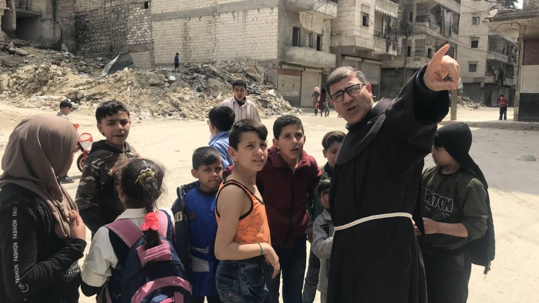 Father Firas Lutfi with children in Aleppo 2020
